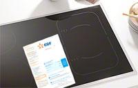 Illustration d'une table de cuisson avec une facture EDF