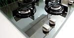 Table de cuisson avec revêtement miroir
